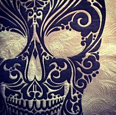 I looooove this detail from a calavera quilt by Karen McTavish.