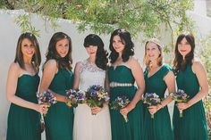 emerald bridesmaid dresses - photo by Studio Castillero http://ruffledblog.com/tropical-glam-wedding-in-palm-springs #bridesmaids #bridesmaidsdresses
