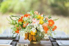 beautiful orange + green centerpiece with poppies, ranunculus, garden roses + a bit o' fruit