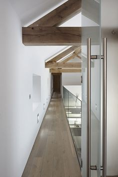 Old Yorkshire barn converted into a modern home by Snook Architects - glass bannisters