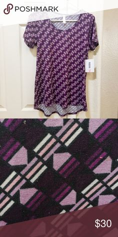 "LuLaRoe Classic T Small Size Small LuLaRoe Classic T  New with tags. Bought as part of an ""outfit"" but it's too big. Colors are dark purple, lavender and black LuLaRoe Tops Tees - Short Sleeve"