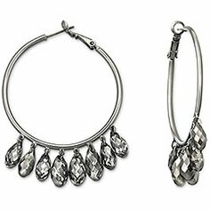 Great to wear casually or for special occasions! This stunning pair of pierced earrings adds dark, shimmering elegance to any look. Each ruthenium-plated hoop is embellished with dangling briolette crystals coated with the special Crystal Silver Night effect.