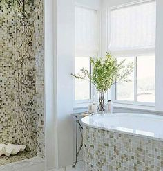 I like how the tile is put directly on the bathtub.    Tranquil Bath < Our 50 Favorite Bathrooms - MyHomeIdeas.com