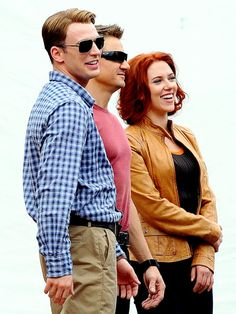 Beautiful people having fun together. Chris Evans, Jeremy Renner, and Scarlett Johanssen on the set of The Avengers