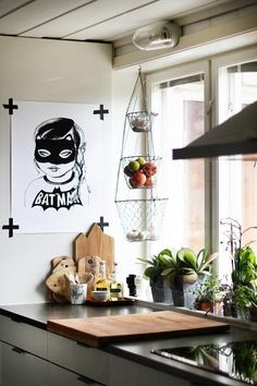 Blogger An Magritt used tape (black, of course — no Washi tape here!) to hang up this poster in her kitchen. It's perfect: Non-permanent, so you can change up your artwork frequently, and still graphic enough to make a statement by itself. Read more at ELLEDecor.com: 16 Things Only People Who Live in the Suburbs Understand   - HarpersBAZAAR.com