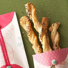 Puff pastry sheets just beg for a good twist. Give them the honor -- with the addition of paprika and sesame seeds -- in these masterpiece breadsticks.
