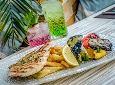An elegant restaurant, a private sandy beach with Tropical blue waters, a cosmopolitan bar with a fresh water pool and a Nomad style lounge area. Style Lounge, Beach Bars, Fresh Rolls, Restaurant Bar, Dishes, Chicken, Ethnic Recipes, Food, Plate