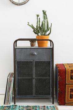 4040 Locust Caged Metal Cabinet - $149.00 Could work well in the corner of the hallway.