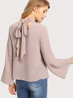 Long Sleeve Blouses. Top Decorated with Tie Neck, Knot. Designed with Stand Collar. Regular fit. Perfect choice for Elegant wear. Plain design. Trend of Spring-2018, Fall-2018. Designed in Pink. Fabric has no stretch.