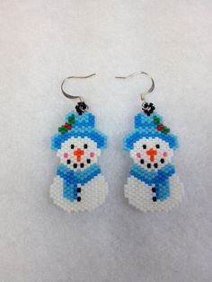 These adorable Snowmen earrings were done in Brick Stitch using Japanese size 11 Delica seed beads. They were carefully woven together one