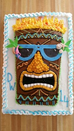 Tiki man cake for 14 year old boy. All buttercream except the glasses and their decorations.