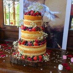 White chocolate and raspberry naked wedding cake