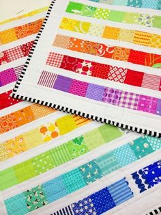 Rainbow Scrap Strip Quilt Tutorial � Free tutorial with pictures on how to make a patchwork quilt in 5 steps