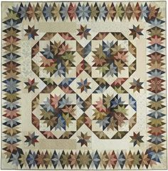 """Capistrano - Stellar Quilts, 2009. Designed and pieced by Judy Martin. Quilted by Lana Corcoran and Debbi Treusch. 110"""" x 110'. Alternate sizes of 77"""" x 110"""" and 66"""" x 66"""" also presented."""