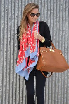 Black outfit with a colorful scarf