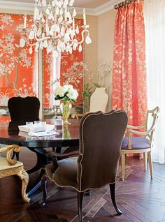 Love the color and pattern for the Living Room. Incorporate color in pillows, books on table, flowers. Pull into formal dining with gray walls/coral tone pattern fabric on chiars.