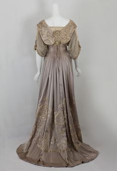 The hem is padded; the interior seams are finely hand finished. The taffeta under bodice is boned. The dress closes in back with hooks. The magnificent dress, which displays beautifully, is priced below market due to a few condition issues, making it a great buy for the collector who wants a superb example of early 20th century couture.