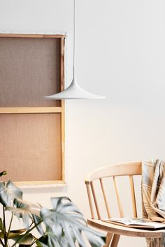 Pendants are one of the most decorative types of light in the home, and with the right pendant, you can create exactly the atmosphere you want. A pendant is defined as a light that hangs from the ceiling. Pendants come in all shapes and sizes, and the possibilities are endless when choosing the right pendant for your home. #Living Room #Dining Room #Interior Design #Inspiration #Décor Ideas #Nordic #Danish Design #Scandinavian #Modern #Minimalist #Pendant #Ceiling Lamp #Lighting Light Bulb Types, Types Of Lighting, Colored Glass, Beams, Shelves, Living Room, Furniture, Room Interior, Interior Design