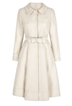 1950s style pure wool twill coat. A beautiful 'proper' coat. A Suzannah signature style. We have produced our Italian cloth winter coat in the most sensational cream wool twill, which is trimmed with 100% cream silk and lined in silk acetate. A beautiful cream silk constructed bow belt announces the waist.  Immaculately tailored with sensational fit and flare fluidity. Below the knee. Beautiful drape, folds and wonderful presence. The coat is a wonderful piece for the day and yet special ...