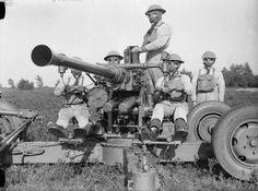 British Army, 1939-45 (H 143)   Bofors gun crew ready for action, wearing gasmasks, November 1939.