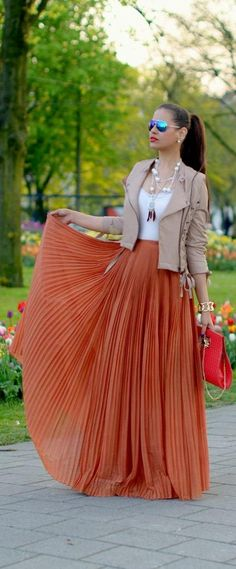 Frilly orange skirt + nude leather jacket.