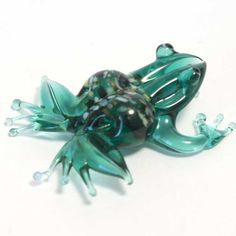 Glass Figurine. Green Frog Figurine is a hand-blown glass figurine which is made by the Ru... http://russian-crafts.com/glass-figurines/glass-reptiles/green-frog.html
