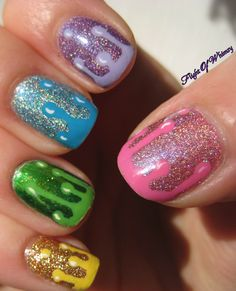 Dripping rainbow nail art with holographic polish too