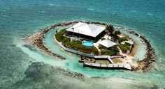 Private Island (1.5 Acres) fully developed and self-efficient, located 1/4 mile off the Atlantic shore of Marathon, Florida Keys. On the island sits a Bahamian style home (+5,000 sf) with a wide veranda and ocean views surrounding it, 3 bed/2bath, open living areas, high ceilings, sliding glass-doors and wood floors throughout  EAST SISTER ROCK ISLAND    Price:USD 12,000,000