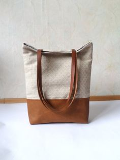 Leather and linen tote bag - caramel brown vegan leather and natural linen in geometry print - large tote, colorblok.  *Exterior: - Bottom - high quality vegan leather in gorgeous warm camel honey brown brown - Top - high quality medium thick and sturdy organic bio geometric print natural linen in oatmeal oclor. * Interior  - Fully lined with sandy beige and white polka dot patterned natural cotton  * Two inside slip pockets for daily belongings like phone, keys, etc. * Additionally lined…