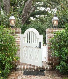 brick and flickering gaslights #currentinspiration #southernliving (via Bevolo).