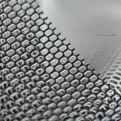 This fabric is a nice mesh fabric fabric, hollow, white and black color.    * Mesh fabric : polyester, hexagon hollow, one side black one side white,