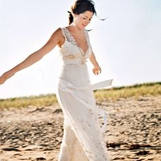 Brides: Casual Summer Wedding Dresses. Beaded gold-leaf appliqués create a glittery floral canvas on this lace Empire-waist gown with a plunging V-neck and open back; a silk ribbon sash provides the finishing touch. About $5,000, Claire Pettibone. Earrings, Susan Suh Jewelry.