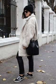 Black beanie, white teddy coat, white t-shirt, black leather leggings, black vans sneakers, black wayfarer sunglasses, a black bucket bag - Teddy coat outfit, teddy coat trend, winter fashion, fashion, fashion 2018, fashion trends 2018, street style, casual outfit, casual winter outfit, black and white outfit, sneakers outfit, comfy outfit.