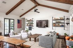 """Out of Chip and Joanna Gaines's massive home overhauls, the """"Little Shack on the Prairie"""" is certainly a memorable Fixer Upper makeover. The Crawford, Texas house is now for sale! Bump, Gaines Fixer Upper, Wooden Shack, Fixer Upper Living Room, Airbnb House, Chip And Joanna Gaines, Entertainment Center Decor, Modern Farmhouse Style, Decoration"""