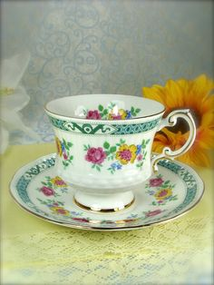Lovely Vintage Pink and Yellow Flower Teacup by HappyGalsVintage