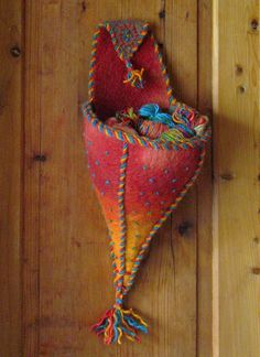 Felted plant holder for walls. You can also keep your bits and bobs in it.. $85.00, via Etsy.