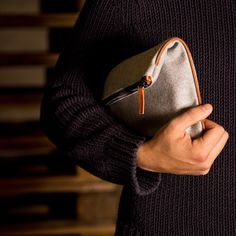 The wool fabric and the vegetable tanned leather pipe...just this...iconic and minimalist...it's our Pouch Heritage...
