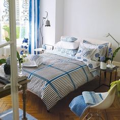 Bedroom, Blue And White Bright Trendy Duvet Cover With The Smart And Beautiful Design Ideas For Your Bedroom With Small Table And Chair With Some Accessories And Flower Vase Also Floor Lamp ~ Make Your Bedroom More Comfortable With Trendy Duvet Covers
