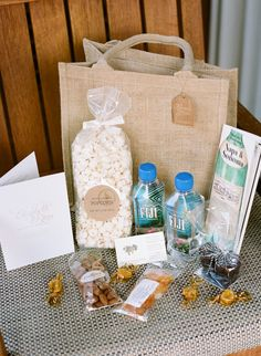 Brides: Creative Wedding Welcome Bag Ideas 16 Wedding Lounge Areas We Love Powered by 17 20 19 Creative Wedding Welcome Bag Ideas Keep your guests from going hungry by providing snacks like popcorn, nuts, and sweet treats. Wedding Favors And Gifts, Wedding Guest Bags, Creative Wedding Favors, Inexpensive Wedding Favors, Beach Wedding Favors, Wedding Day, Wedding Souvenir, Nautical Wedding, Party Favors