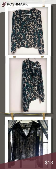 Nine West Blouse Nice blouse with animal print and a cowl neck,  few pleats under neckline ,  front liner.. button sleeves  Nice&light&flowy... 100%Polyester Nine West Tops Blouses