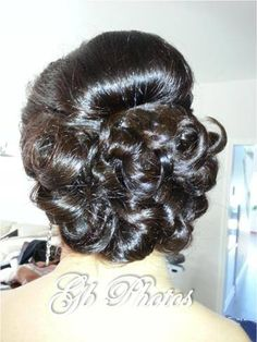 Updo on the groom's mother. Simple and classy :)