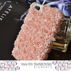 ok really like this iPhone case, made with pink chiffon roses and has white pearls and Swarovski Crystals