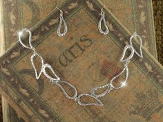 designer silver teardrop necklace set