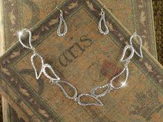 designer silver teardrop necklace set