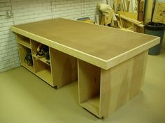 It's skinned with MDF on each side and the top is hardboard. The hardboard just sits inside the pine edging and is not fastened so I can replace it when it gets tra. Woodworking Journal, Woodworking Shop, Conservation, Workshop Organization, Workshop Ideas, Assembly Table, Home Blogs, Torsion Box, Diy Storage