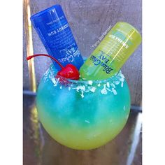 Yellow Layer 1 oz. (30ml) Pineapple Vodka 1 oz. (30ml) Pineapple Juice 1/4 oz. (7.5ml) Lime Juice  Blue Layer: 1/2 oz. (15ml) Coconut Vodka 1/2 oz. (15ml) Blue Curaçao 1/2 oz. (15ml) Blue Island Puckers Top off with lemon lime soda 1 Mini Bottle of Banana Rum 1 Mini Bottke of Coconut Rum Rim with light agave Nectar & Coconut Garnish: Cherry  Instagram Photo Credit: @calimixers  Watch us make The Barbados Surprise Cocktail with Tipsy Girl Inna!