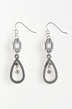 Geometric Acrylic Drop Earrings- Geometric acrylic shapes dangle from sterling silver filled ear hooks. Delicate iridescent green beads hang down from the middle of the droplets. Acrylic Shapes, Geometric Jewelry, Iridescent, Jewelry Collection, Hooks, Indigo, Glass Beads, Dangles, Middle