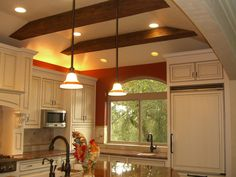 Open Ceiling Kitchens | Exposed beams to ceiling . Lighting is hi-low, dusk-to dawn security ...