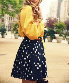 Love the bright yellow  blouse with the high waist polka dot skirt<3 So classy!!!