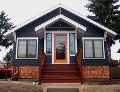 navy blue house with tangerine orange door House Paint Exterior, Exterior Paint Colors, Exterior House Colors, Exterior Design, Exterior Trim, Exterior Houses, Dark Blue Houses, Navy Houses, Outdoor Paint Colors